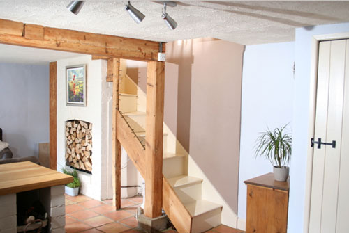 exposed light wood beam in english cottage including exposed staircase