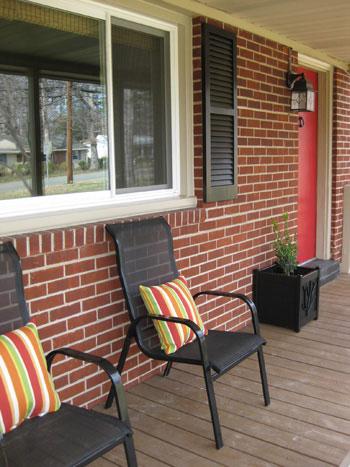 front-porch-decorating-seating-area-doorway-planter-red-door