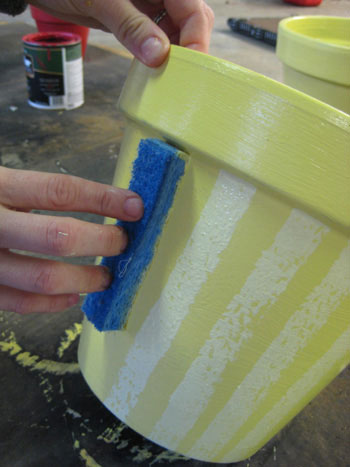 sponging striped paint pattern to terra cotta pot