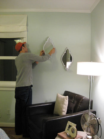 john-hangs-the-sconces-on-the-wall