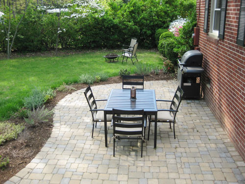 Our 319 patio makeover complete with loungers a fire for Cheap garden patio ideas