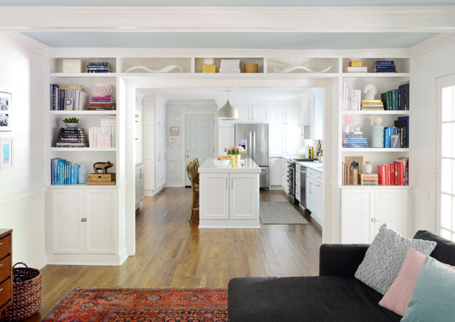 Adding built in bookshelves around our living room doorway for Built ins living room ideas