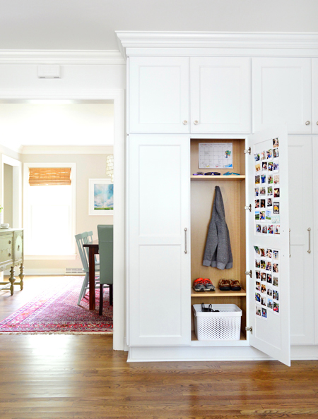 white-kitchen-remodel-hidden-mudroom-cabinet