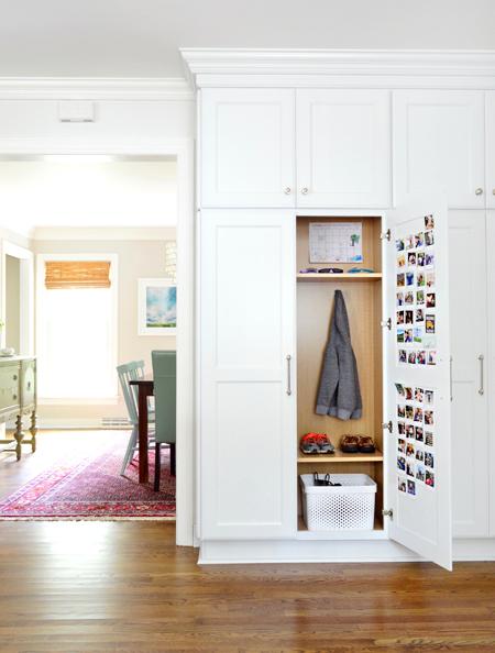 white-kitchen-remodel-hidden-mudroom-cabinet