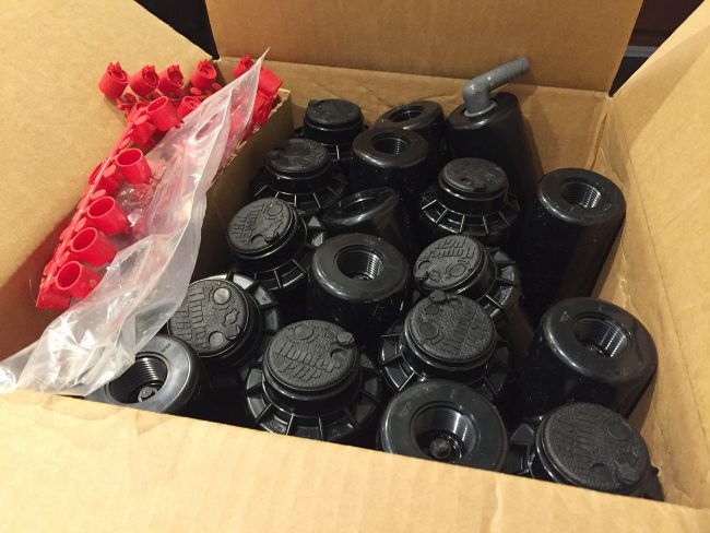 box full of hunter php sprinkler heads for irrigations system