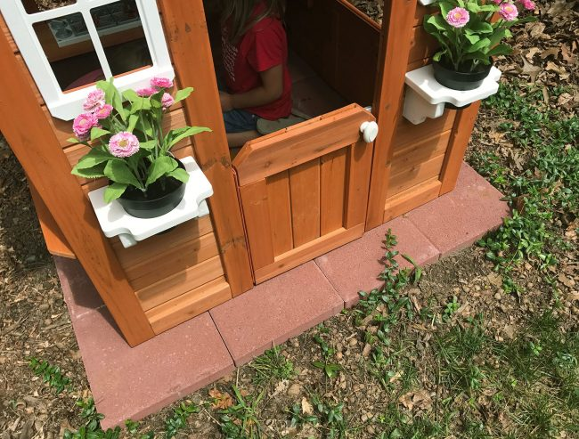 backyard discoveries cedar wooden playhouse with red paver base