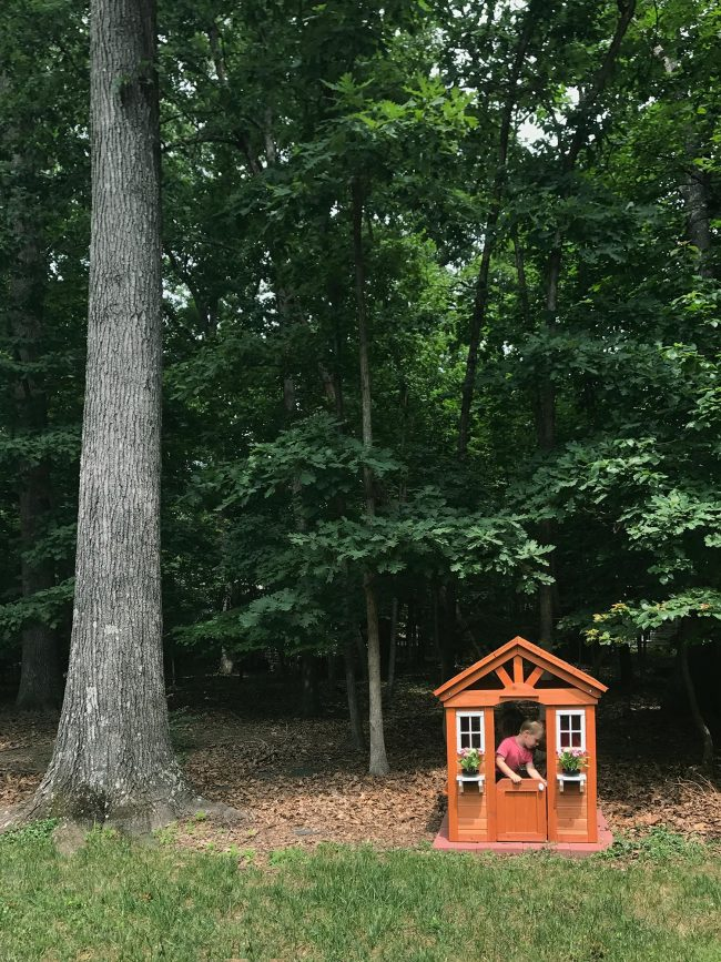 backyard discoveries cedar wooden playhouse next to large tree