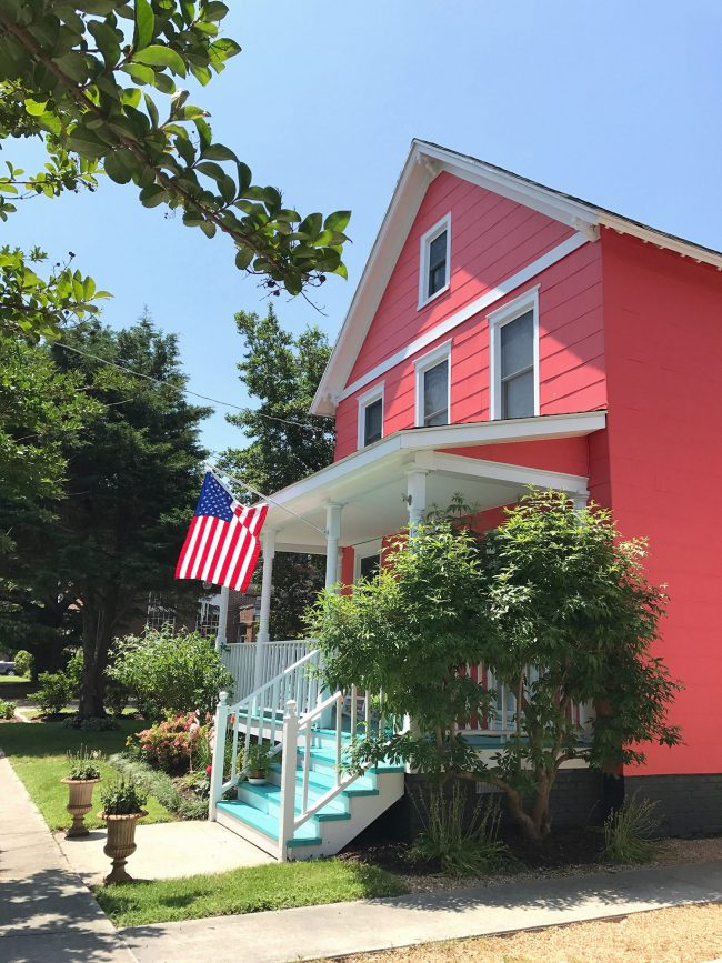 patriotic front porch bright pink house blue porch stairs