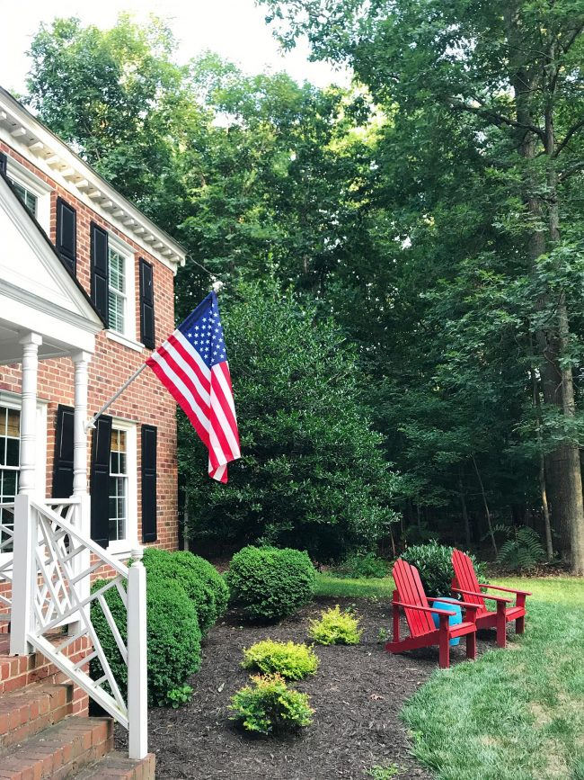 patriotic front porch on brick colonial home outdoor chairs