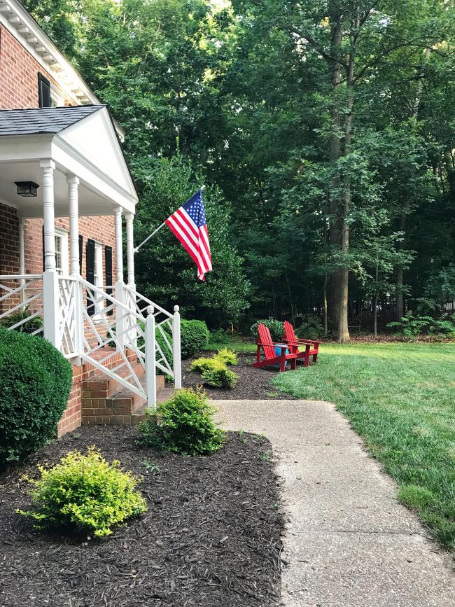 patriotic front porch with american flag red chairs blue ottoman