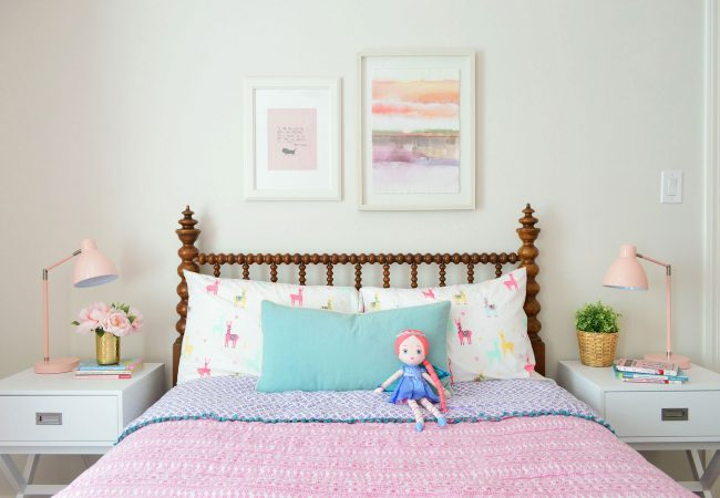 girls bedroom wooden headboard art above bed