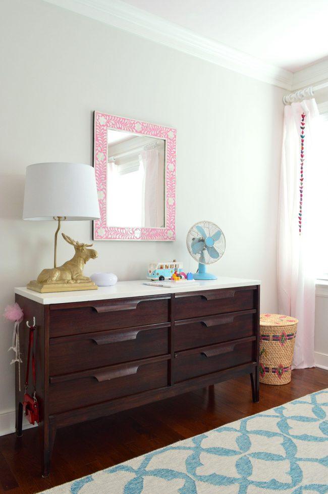 girls bedroom midcentury dresser pink mirror